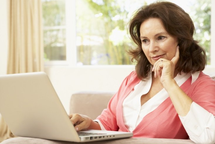 Menopause Woman with computer CanadianPharmacyMeds.com