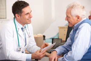 Doctor speaking with elderly patient CanadianPharmacyMeds.com