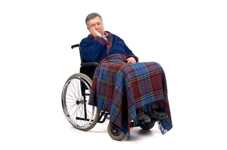 Man covered up and sleeping in wheel chair CanadianPharmacyMeds.com