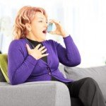 Woman using inhaler CanadianPharmacyMeds.com