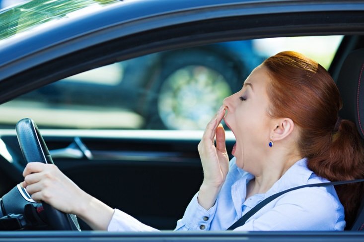 Woman sneezing while driving CanadianPharmacyMeds.com