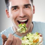Man trying to be healthy by eating a salad CanadianPharmacyMeds.com